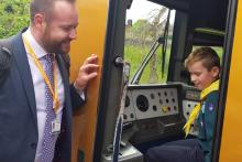 Paul Cassidy, area conductor manager for West Midlands Railway, showing some of the Scouts the inside of a train cab at Redditch station.