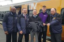 Revenue protection and security managers from across the West Midlands and station staff from Wolverhampton handing over old uniforms to Justin Frost from The Salvation Army Trading Company