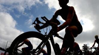 Competitors take part in the cycling stage during the Dextro Energy Triathlon ITU World Championship, London