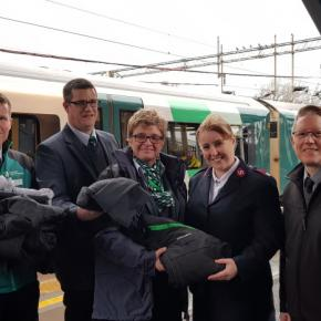 Platform and ticket office staff at Northampton station, handing over old uniforms to Major Janice Snell from the Northampton branch of The Salvation Army and Justin Frost from The Salvation Army Trading Company.