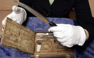 Royal College of physicians and surgeons in Glasgow curator Carol Parry holds one of the surgical instruments used by William Beatty, who tended to the dying Lord Nelson at the battle of Trafalgar